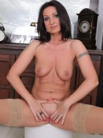 Danni Stash - Beautiful brunette MILF Danni Stash spreads her stocking clad legs