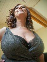 Cum between her big tits