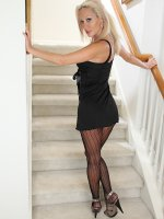 Sexy older babe Brea strips naked on the stairs.