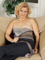 Katriss - 43 year old Katriss from AllOver30 pulls her pussy wide on the couch