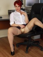 Andrea Rosu - Horny red headed office MILF Andrea Rosu plays with her shaven pussy