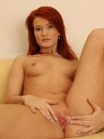 Seductive mature redhead Lucy Red posing naked in heels.