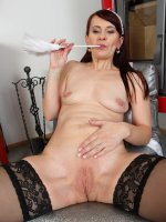 Vera Delight - Mature maid Vera Delight strips and slides her feather duster deep