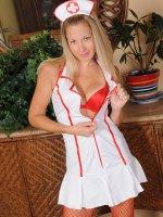 Slutty MILF Nurse Chelsea Dunes strips butt naked.