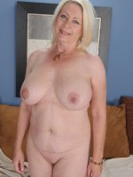 Horny granny Angelique spreads her older pussy.