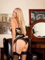 Stunning older blond Amber Jayne wearing only her stockings.