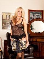 Stunning older blond Amber Jayne wearing only her stockings.