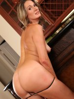 Tall tight MILF Misty Law fingers her pussy.