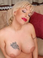 Busty mature babe Kelly Lenox spreads pussy.