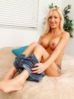 Blonde cougar Zoey Portland stuffs her dildo deep inside her.