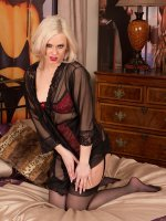 Seductive MILF Anna Joy in black stockings.