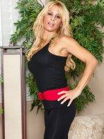 Busty blonde cougar Alyssa Lynn spreads her pussy lips.