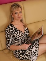 Busty cougar Samantha Marty masturbates on the sofa.