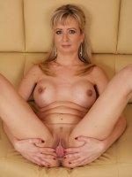 Busty cougar Samantha Marty masturbates on the sofa.