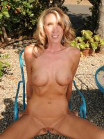 Brynn Hunter,  Tall slim blonde Brynn Hunter showing off her full body tan outdoors