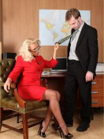 Blonde office slut Lana gives her staff a footjob
