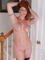 Big breasted older redhead Sara Orlando in only heels.