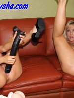Naughty Alysha and Angie Noir take turns beating each others pussy with some huge toys.