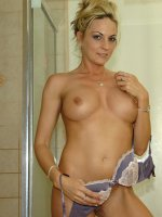 Blonde cougar Sindy Lange dildos pussy in the shower.