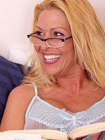 Older babe Kaycee James works her terrific oral skills.