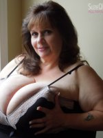 Sexy bbw milf Suzie 44K is horny. Her big tits are out and swollen. When she lets guys see her tits