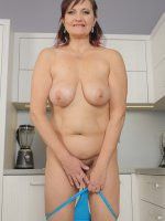 Justina - In the kitchen 45 year old Justina gets naked and plays with her food