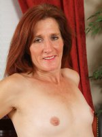 Monica E - 46 year old and redheaded Monica E slips out of her slinky ligerie