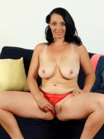 Leona Sweet	Busty 37 year old Leona Sweet lets loose her massive mams in here
