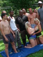 Two horny girls get fucked outdoors by a group of guys