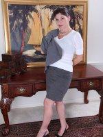 Arden Delaney peels off her business suit after work.