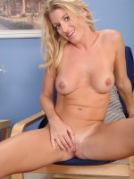 Beautiful blond MILF Avona Dominica spreads pussy lips.