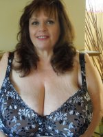 Suzie is in her sexy plus size lingerie. Her big boobs are poking out and her soft thighs are ready.