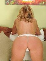 Tall busty cougar Brynn Hunter strips butt ass naked.