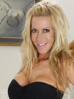 Gorgeous older blonde Pamela Rivett spreads her pussy lips.