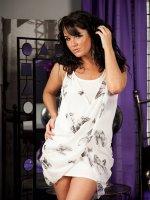 Gorgeous cougar Danielle Leah Raven strips butt naked.