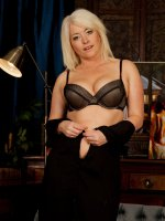 Blonde cougar Amber Jewel naked in only stockings.