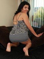 Busty Latin MILF Sofia Reyes spreads her pussy lips.