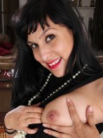 Exotic MILF Penelope Patterson spreads her hairy pussy lips.