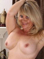 Blond cougar Aubrey Adams spreads trimmed pussy.