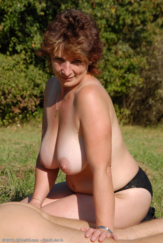 Busty mature outdoors