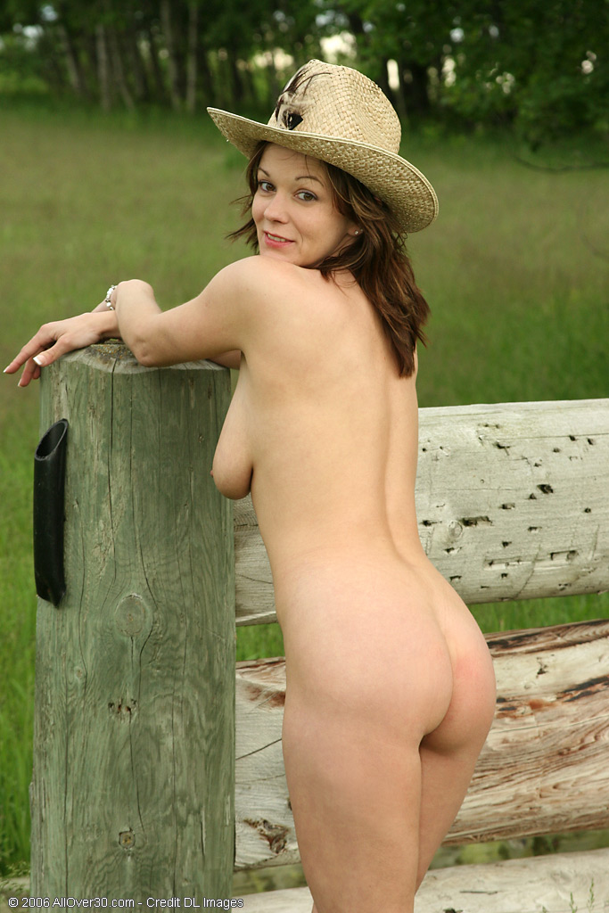 image Curvy brunette milf demonstrates her oiled body