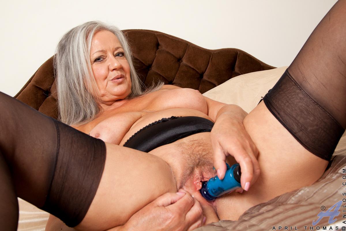 April Thomas - busty BBW mature madam stuffs her pussy ...