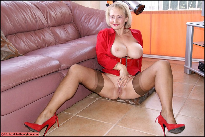 Mature milf rider on a dildo shaking with huge tits 1