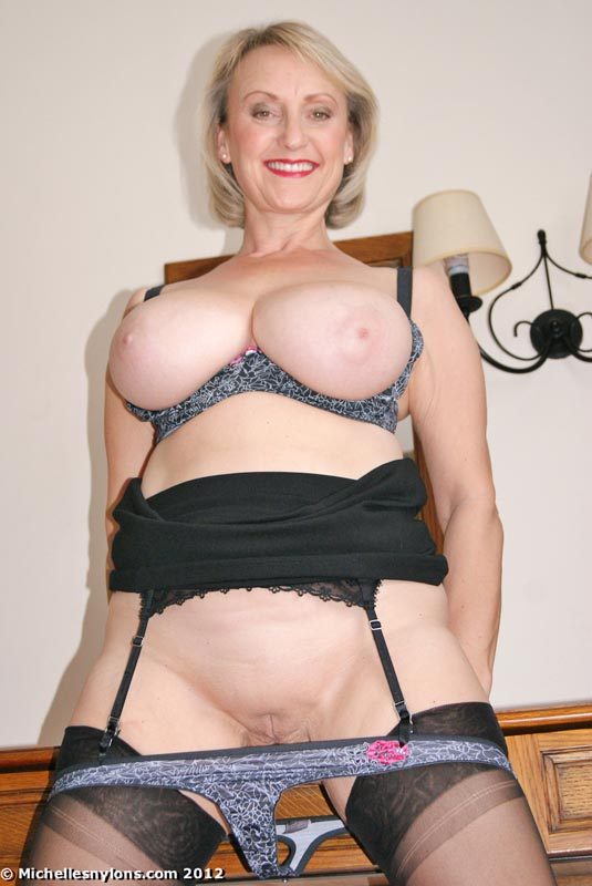 Big boobed blonde plays with herself for your pleasure