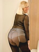 Mature Sandy wears see through lingerie and black stockings and shows her hot body