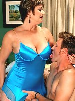 Gorgeous busty mature Victoria Peale dresses in sexy blue lingerie takes that cock into her old hole