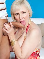 Sweet older blonde Lola Lee shows her perfect big boobs and rides younger dick