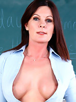 Slutty teacher in black stockings riding her student's dick in the classroom