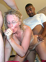 Amateur slut MILF Cathy sucking her husband off while being fucked by black dick from behind