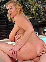 Busty MILF gets laid after sunbathing by the pool